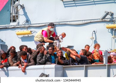 North African migrants refugees on a ship in the port of Taranto, Puglia, Italy - August 2015