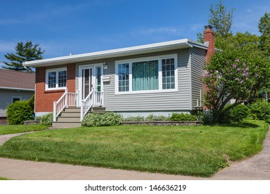 North America sixties era wooden bungalow  in suburbia.