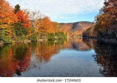 The North Aspy River in Cape Breton, Nova Scotia during peak fall colours.