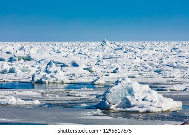 North Atlantic ocean pack-ice, a jumble of thick heavy ice floes stretching to a distant horizon