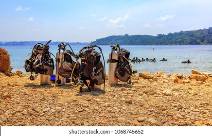 North Bay island, Andaman, India, March 26,2018: Scuba diving equipments on the sea shore at North Bay island Andaman overlooking the sea with submerged divers.
