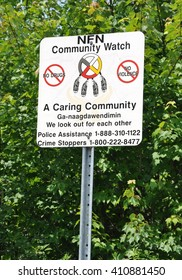 North Bay, Ontario, Canada - July 14, 2015; Nipissing First Nation community watch sign posted along the road.