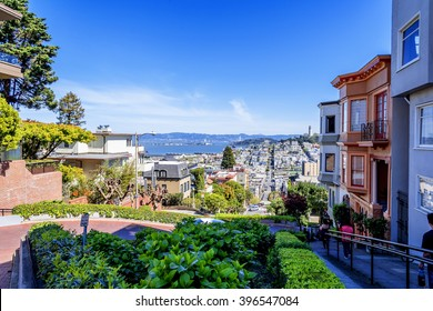 North Beach, Treasure Island, East Bay, Oakland, and Coit Tower photographed from the top of famous Lombard street in the Russian Hill and Nob Hill area of San Francisco, California, USA