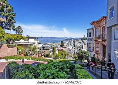 North Beach, Treasure Island, East Bay, Oakland, and Coit Tower photographed from the top of famous Lombard street in the Russian Hill and Nob Hill area of San Francisco, California, USA.