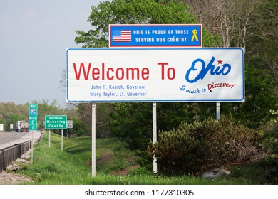 NORTH BEAVER TOWNSHIP, PA / USA - MAY 15, 2018: Road sign located along Route 76 West welcomes drivers to Ohio, also known as the Buckeye State.