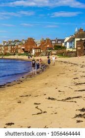 North Berwick, East Lothian, Scotland, UK July, 12, 2017. Tourists walking along the beach on sunny afternoon.