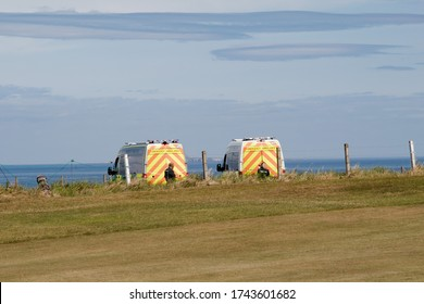 North Berwick/East Lothian, Scotland - May 28 2020: Ambulance first aid emergency responder at seaside beach emergency on call out NHS paramedic