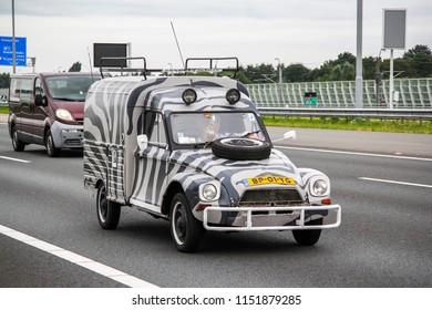 North Brabant, Netherlands - August 10, 2014: Travel car Citroen 2CV at the interurban road.