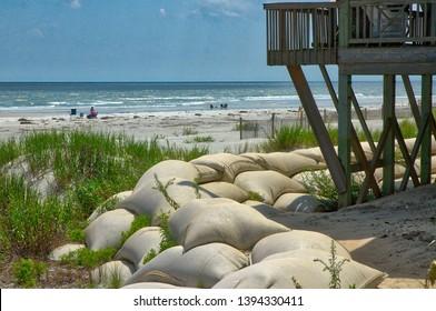 North Carolina Beach hurricane awareness. Coastal landscape. sandbags hurricane preparation. Hurricane season.