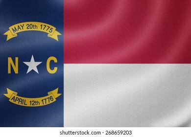 North Carolina flag on the fabric texture background