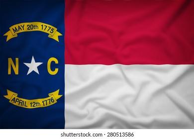 North Carolina flag on the fabric texture background,Vintage style