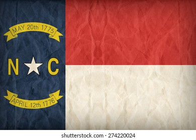 North Carolina flag on paper texture,retro vintage style