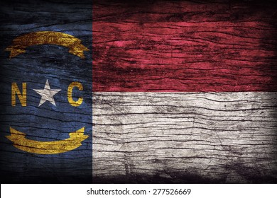 North Carolina flag pattern on wooden board texture ,retro vintage style