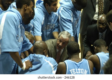 North Carolina men's basketball coach Roy Williams fires up his team in a huddle