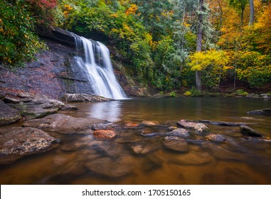 North Carolina nature waterfall photography autumn outdoors scenic landscape of fall foliage at Silver Run Falls, a popular Blue Ridge Mountains waterfall in the Pisgah National Forest.