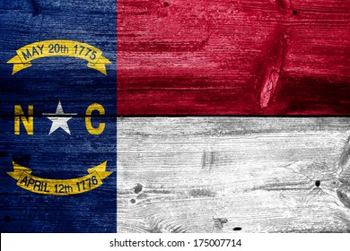 North Carolina State Flag painted on old wood plank texture