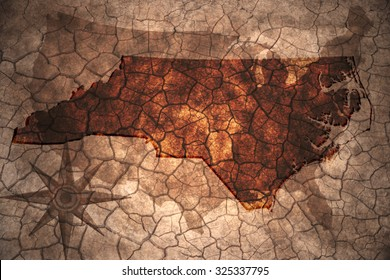 North Carolina state map on vintage usa map, crack paper background