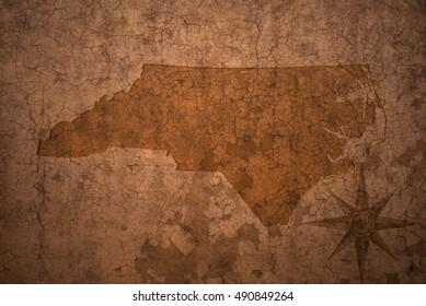 north carolina state map on a old vintage crack paper background