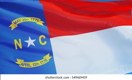 North Carolina (U.S. state) flag waving against clear blue sky, close up, isolated with clipping path mask alpha channel transparency, perfect for film, news, composition