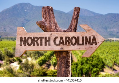 North Carolina wooden sign with landscape background
