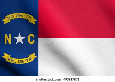 North Carolinian official flag, symbol. American patriotic element. USA banner. United States of America background. Flag of the US state of North Carolina waving in wind with detailed fabric texture