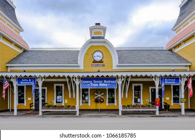 North Conway, NH, USA - Circa September 2016: Exterior view of a historic, timber-built railroad station showing detail of the gift shop and railroad entrance together with its fine architecture.