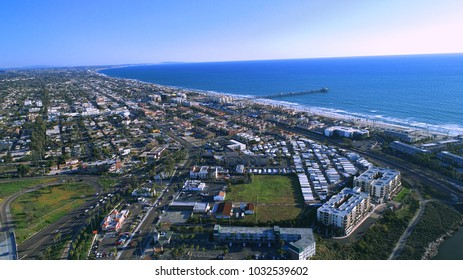 North county San Diego Oceanside pier and surrounding suburbs, business, parks, and highways, with views of Carlsbad and the Pacific Ocean.