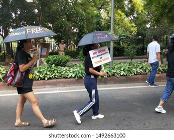 North Delhi/India-30th Aug, 2019 College going tibetan girls peacefully walks ahead to Jantar Mantar by holding banners and slogans under black umbrella in standing solidarity with the Hong Kongers.