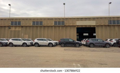 North District, Israel - January 11, 2019: Rows of Brand new cars covered with white protective sheets parked at a holding platform waiting to be purchased.