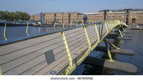 North Dock footbridge from Wren Landing in Canary Wharf - LONDON / ENGLAND - SEPTEMBER 14, 2016