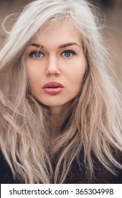North Eastern European girl with striking blue-green eyes and windswept ash blonde hair