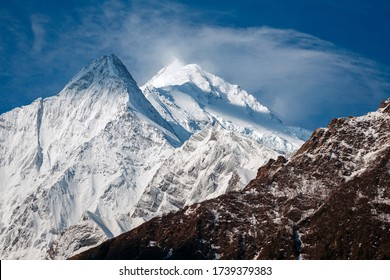 North face of Annapurna II mountain, view from circuit trek, telephoto lens