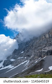 The north face of the eiger cover in clouds from the eiger trail,Bernese Alps, Jungfrau Region, Switzerland