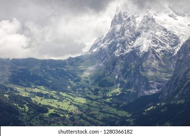 The north face of the infamous Eiger mountain in Switzerland with the town of Grindelwald nestled in the valley below.