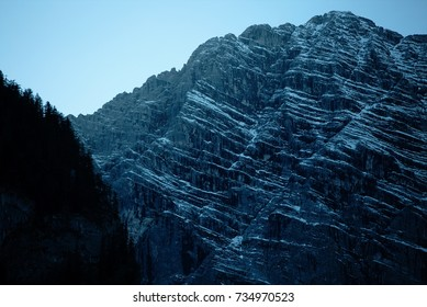 North face of a mountain textured with snow