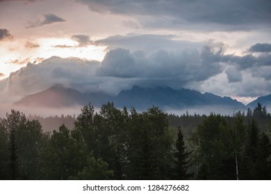 North Fork Flathead River. Low hanging clouds shroud the Boundary Mountains