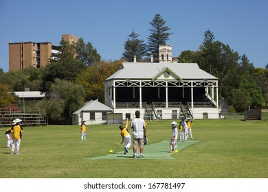 NORTH FREMANTLE, AUSTRALIA - DECEMBER 15: Young cricketers play at North Fremantle, Perth on December 15, 2013. Cricket is often known as Australia's national sport and is played at all levels there.