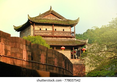 North Gate Tower and Tuojiang River in Fenghuang, Hunan Province, China.