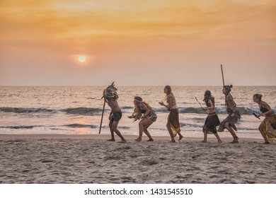 North Goa, Arambol / India - December 2018: people relaxing on the beach savages cannibals staging
