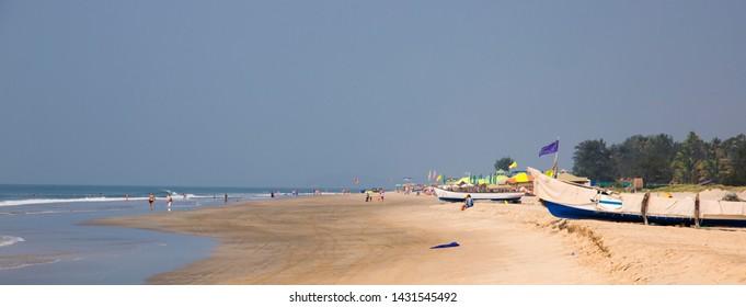 North Goa, Arambol, Mandrem / India - December 2018:   Indian boats and fishermen