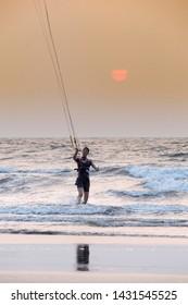 North Goa, Arambol, Mandrem / India - December 2018:people leading a healthy lifestyle, play sports