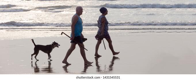 North Goa, Arambol, Mandrem / India - December 2018: people relax on the beach
