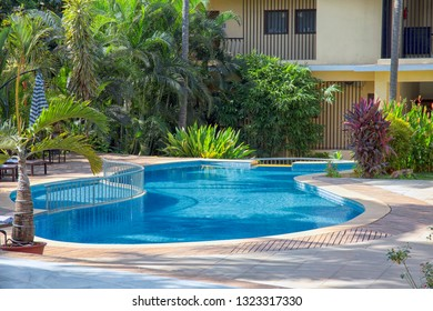 North Goa / India - Dec 2018 : the hotel Sol Beso Hotel Goa with a pool, loungers and umbrellas in Arpora