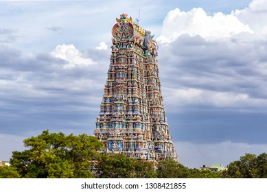 The north gopuram of the Meenakshi temple in Madurai, India. A Gopuram is a monumental gatehouse tower, usually ornate, at the entrance of a Hindu temple usually found in the southern India