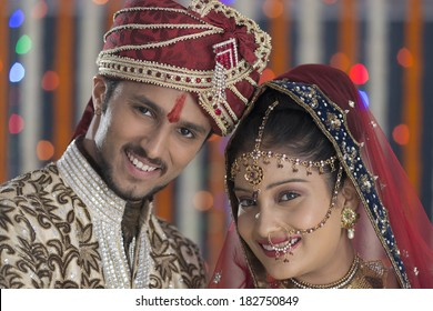 north indian hindu wedding bride and groom smiling and happy