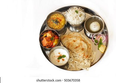 North Indian Thali isolated on white overhead view with copy space