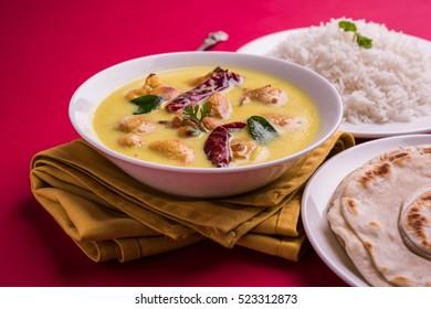 North India's popular food Kadhi Pakoda or pakora with laccha paratha or roti and cooked basmati rice