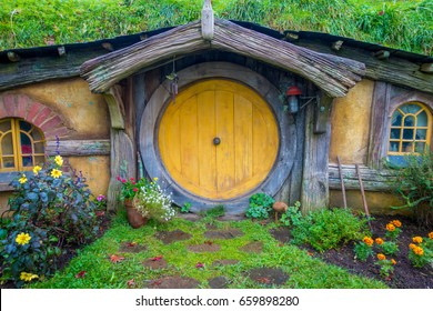 NORTH ISLAND, NEW ZEALAND- MAY 16, 2017: Hobbit house with yellow door, hobbiton movie set, site made for movies: Hobbit and Lord of the ring in Matamata, north island of New Zealand