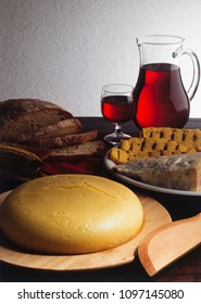 North Italy traditional food, polenta of corn flour and gorgonzola cheese, red wine