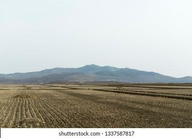 North Korea APRIL 17 2013: Spring drought rice fields landscape in North Korea